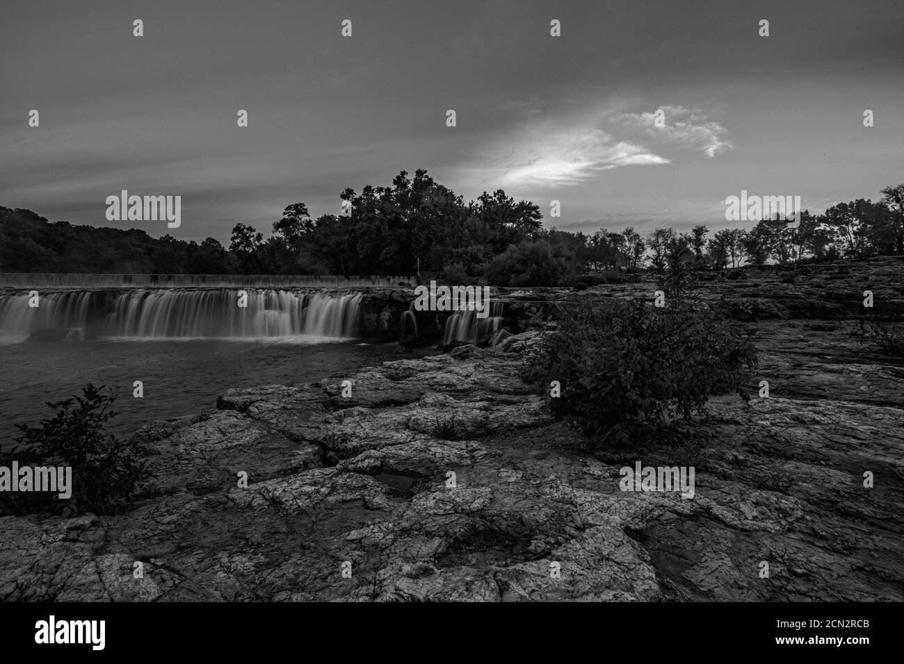 Grand Falls waterfall is the largest continuously flowing natural waterfall in Missouri. It is located in Joplin in the southwest region of Missouri. Stock Photo