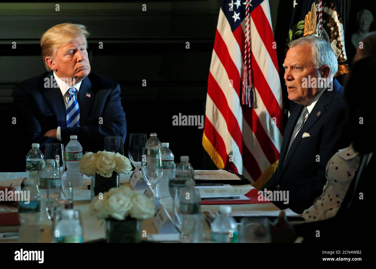 U.S. President Donald Trump listens to Governor Nathan Deal (R-GA) of Georgia as they participate in a roundtable discussion with state leaders on prison reform in Berkeley Heights, New Jersey, U.S., August 9, 2018.  REUTERS/Carlos Barria Stock Photo