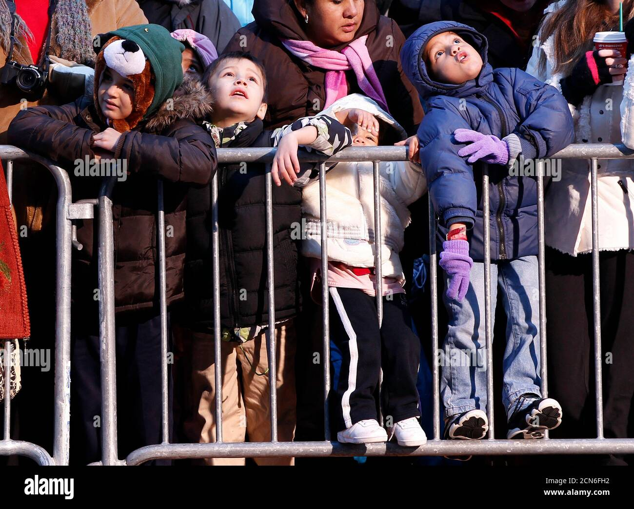 People watch as floats make their way through Times Square during the 85th annual Macy's Thanksgiving day parade in New York November 24, 2011. REUTERS/Shannon Stapleton (UNITED STATES - Tags: ENTERTAINMENT SOCIETY) Stock Photo