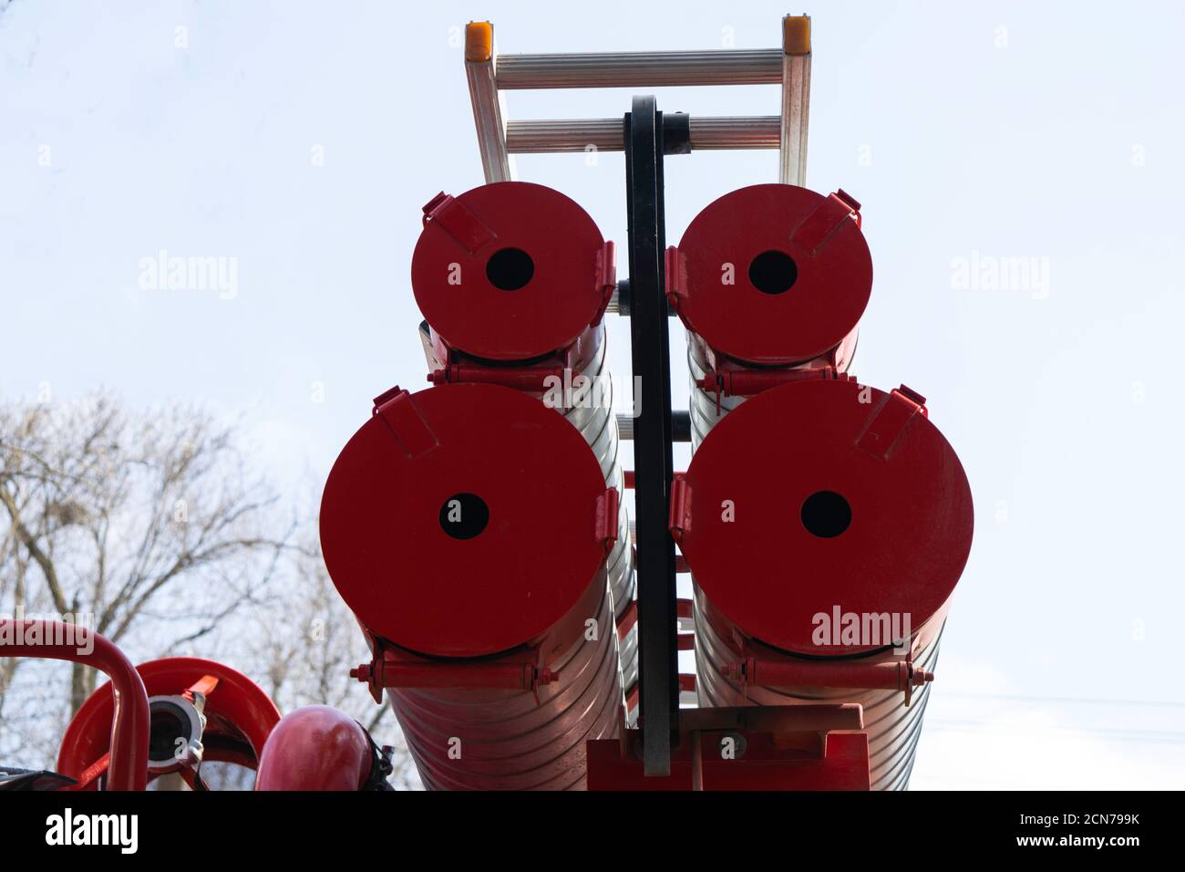 a fire truck, rear view of canisters for transporting suction hoses with fire escapes attached to them Stock Photo