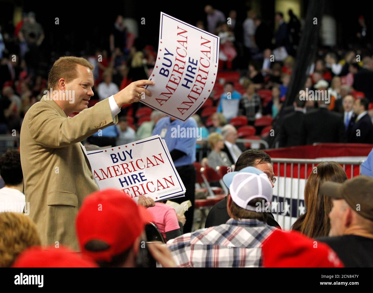 U.S. President Donald Trump campaign staffers pass out posters to fans as they wait for his arrival at a campaign stop in Louisville, Kentucky,  March 20, 2017.  REUTERS/John Sommers II Stock Photo