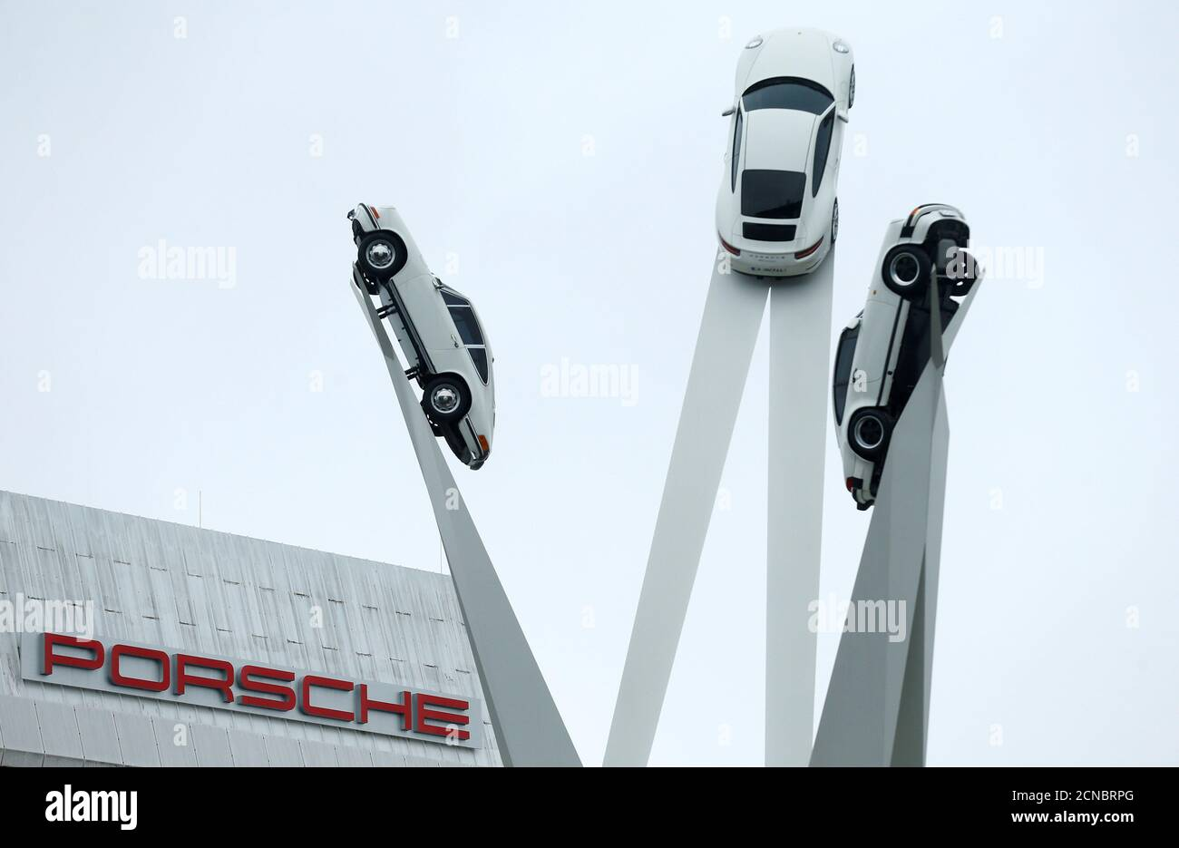 A sculpture featuring models of German car manufacturer Porsche is seen outside the Porsche factory in Stuttgart-Zuffenhausen, Germany, January 26, 2018.   REUTERS/Ralph Orlowski Stock Photo