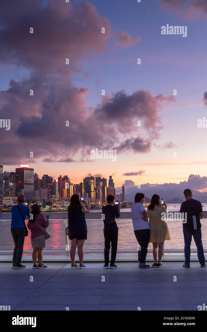 People watching sunset from Harbour City, Hong Kong, China, Asia Stock Photo