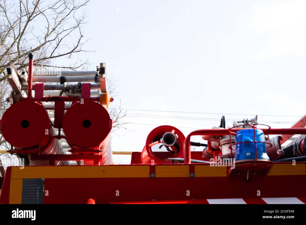 a fire truck, rear view of canisters for transporting suction hoses with fire escapes attached to them, copy space Stock Photo