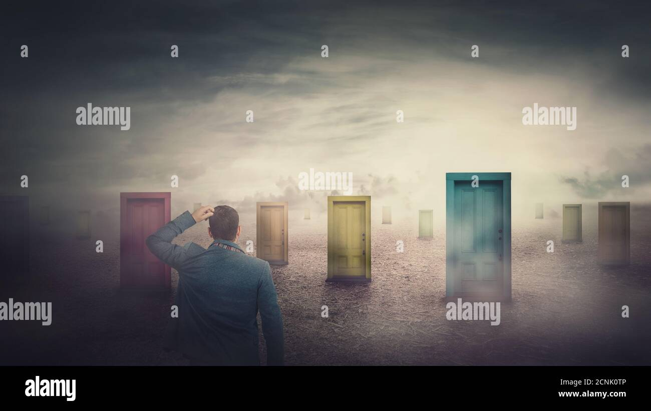 Rear view businessman in front of many different doors choosing one. Difficult decision, important choice, failure or success concept. Decisive ways t Stock Photo