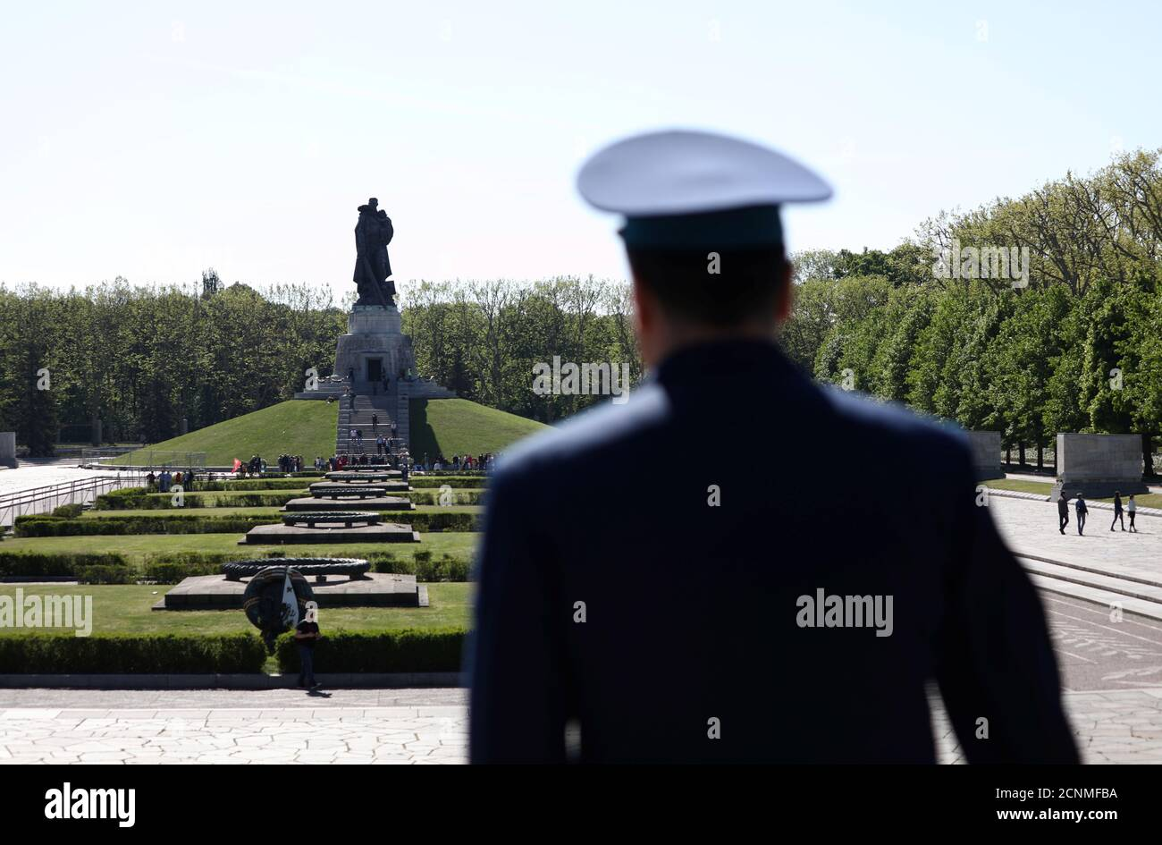 People gather at the Soviet War Memorial at Treptower Park, to mark Victory Day and the 75th anniversary of the end of World War Two, in Berlin, Germany May 9, 2020. REUTERS/Christian Mang Stock Photo