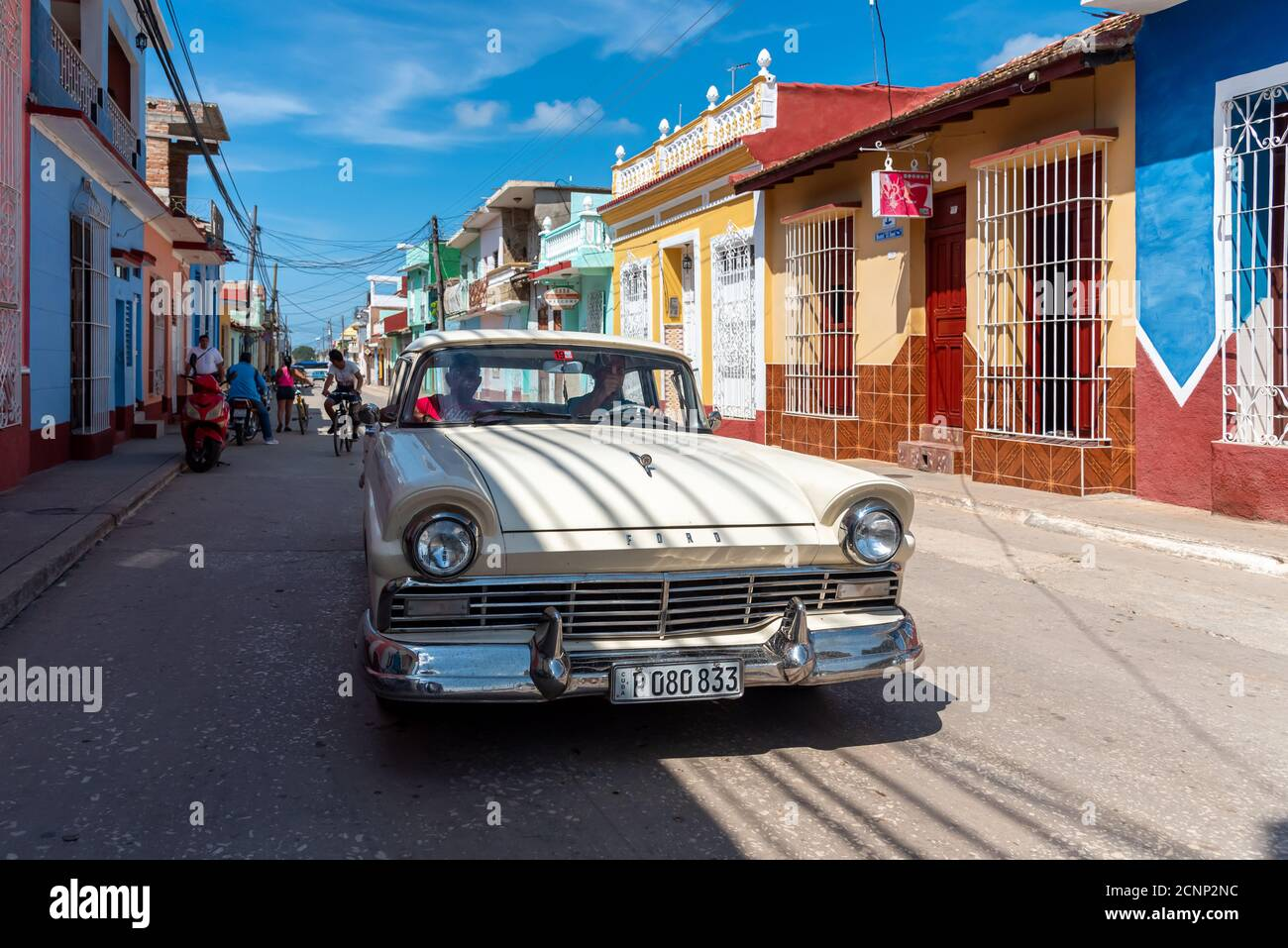 August 26, 2019: Street scene with an old American car on the cobblestone street. Trinidad, Cuba Stock Photo