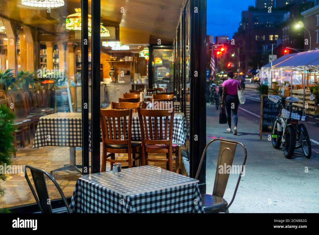 Empty indoor seating at a restaurant in the Chelsea neighborhood of New York on Thursday, September 10, 2020. NYS Gov. Andrew Cuomo announced that restaurants will be able to commence indoor dining on Sept. 30 with 25% capacity and other restrictions. (© Richard B. Levine) Stock Photo