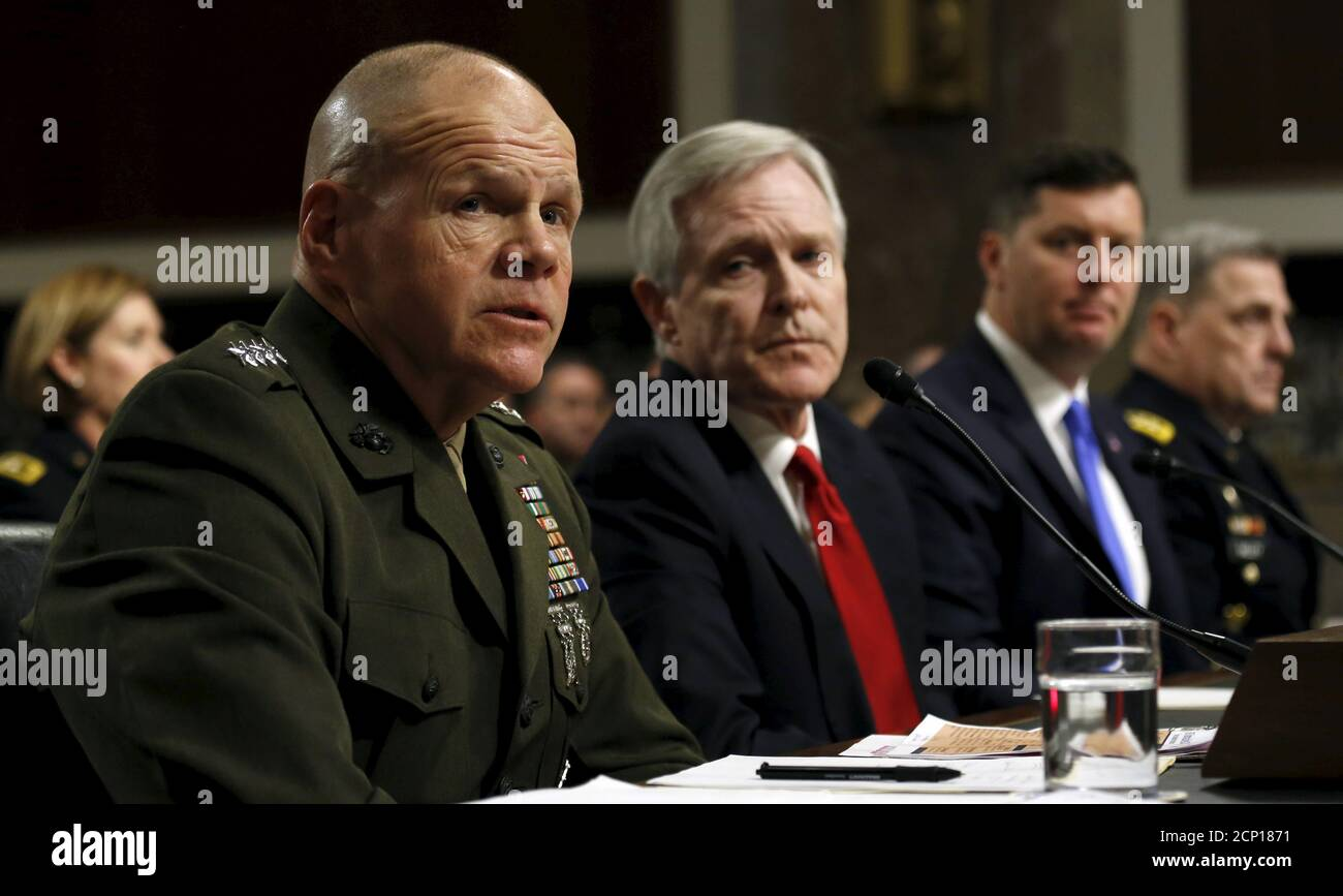 Commandant of the U.S. Marine Corps Gen. Robert Neller (L) testifies during a Senate Armed Services Committee hearing on the implementation of the decision to open all ground combat units to women on Capitol Hill in Washington, February 2, 2016. Seated from left are Neller, U.S. Navy Secretary Ray Mabus, Under Secretary of the Army Patrick Murphy and Army Chief of Staff Gen. Mark Milley.  REUTERS/Kevin Lamarque? Stock Photo