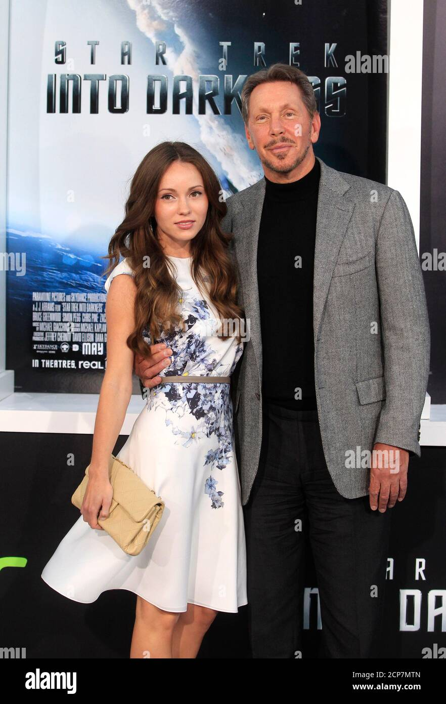 """Oracle CEO Larry Ellison and Nikita Kahn arrive as guests for the premiere of the new film """"Star Trek Into Darkness"""" in Hollywood May 14, 2013. Ellison's son David is the executive producer of the film. REUTERS/Fred Prouser (UNITED STATES - Tags: ENTERTAINMENT BUSINESS) Stock Photo"""