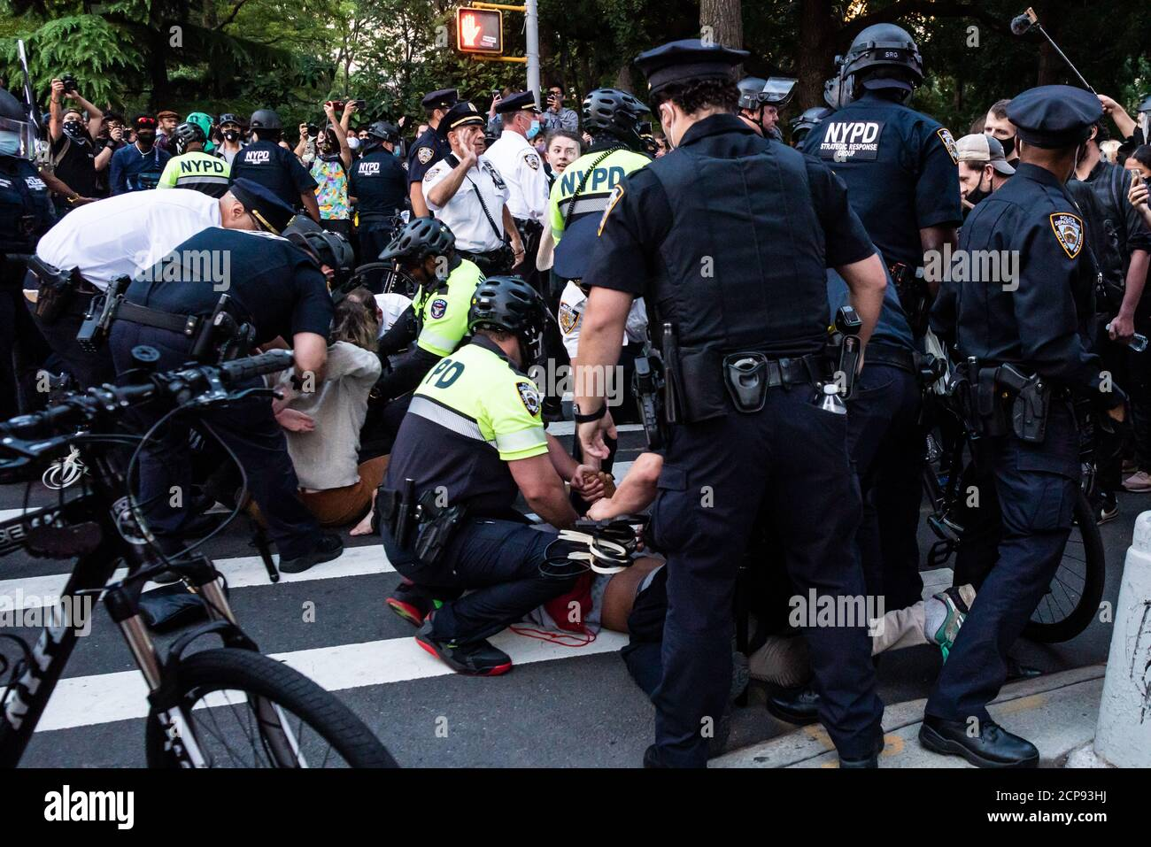 A protestor is arrested by NYPD offiicers during a demonstration against Immigration and Customs Enforcement in New York City on September 18, 20202. For a third day in a row, protestors demonstrated against alleged accusations that a physician perfomed medically unnecessary hysterectomies on undocumented women in I.C.E. custody. (Photo by Gabriele Holtermann/Sipa USA) Credit: Sipa USA/Alamy Live News Stock Photo