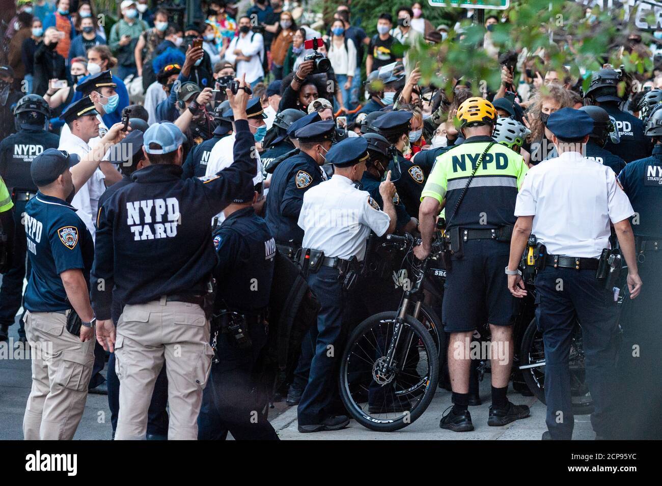 Protestors are arrested by NYPD offiicers during a demonstration against Immigration and Customs Enforcement in New York City on September 18, 20202. For a third day in a row, protestors demonstrated against alleged accusations that a physician perfomed medically unnecessary hysterectomies on undocumented women in I.C.E. custody. (Photo by Gabriele Holtermann/Sipa USA) Credit: Sipa USA/Alamy Live News Stock Photo