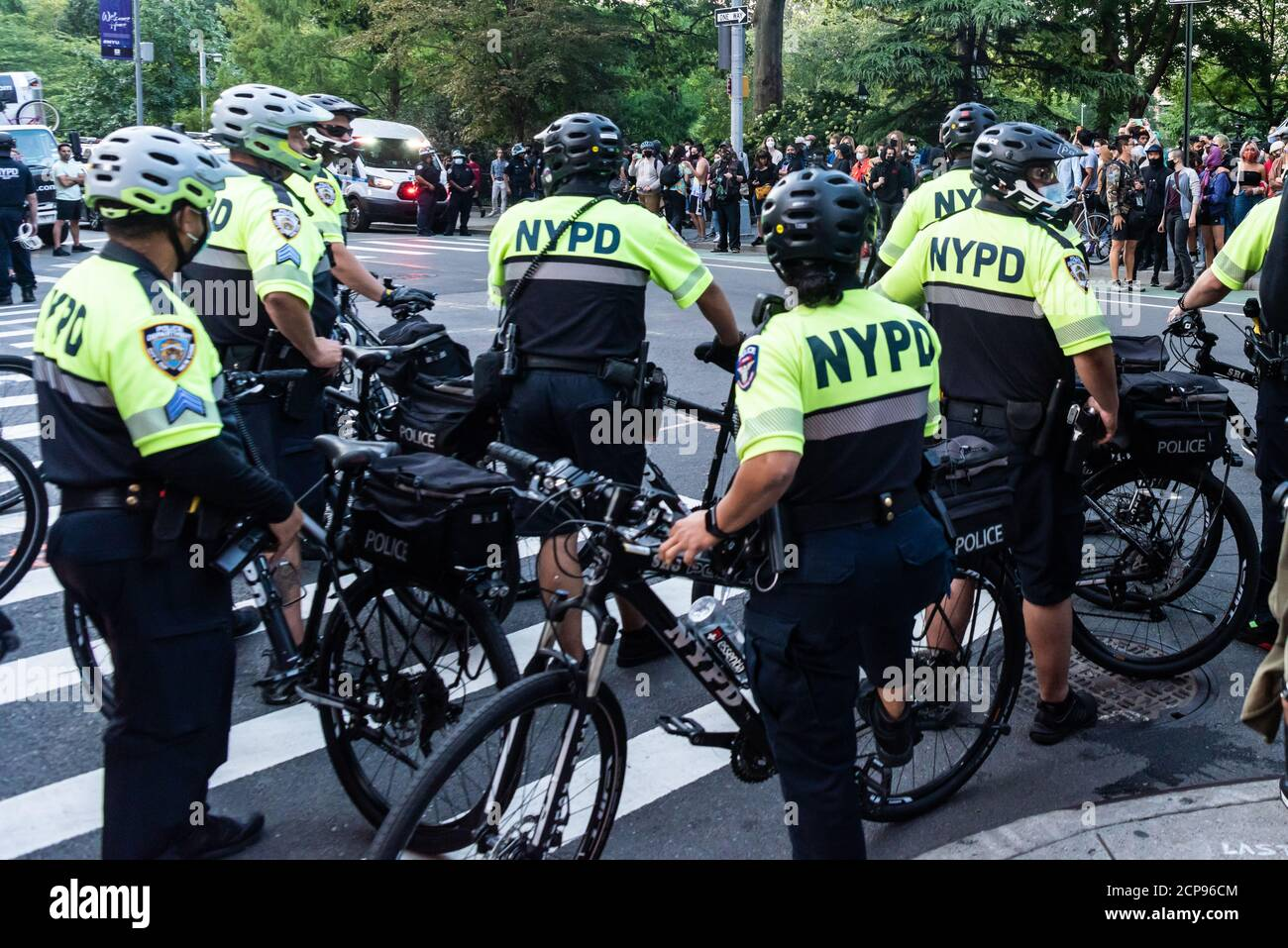 NYPD officers monitor protesters during a demonstration against Immigration and Customs Enforcement in New York City on September 18, 20202. For a third day in a row, protestors demonstrated against alleged accusations that a physician perfomed medically unnecessary hysterectomies on undocumented women in I.C.E. custody. (Photo by Gabriele Holtermann/Sipa USA) Credit: Sipa USA/Alamy Live News Stock Photo