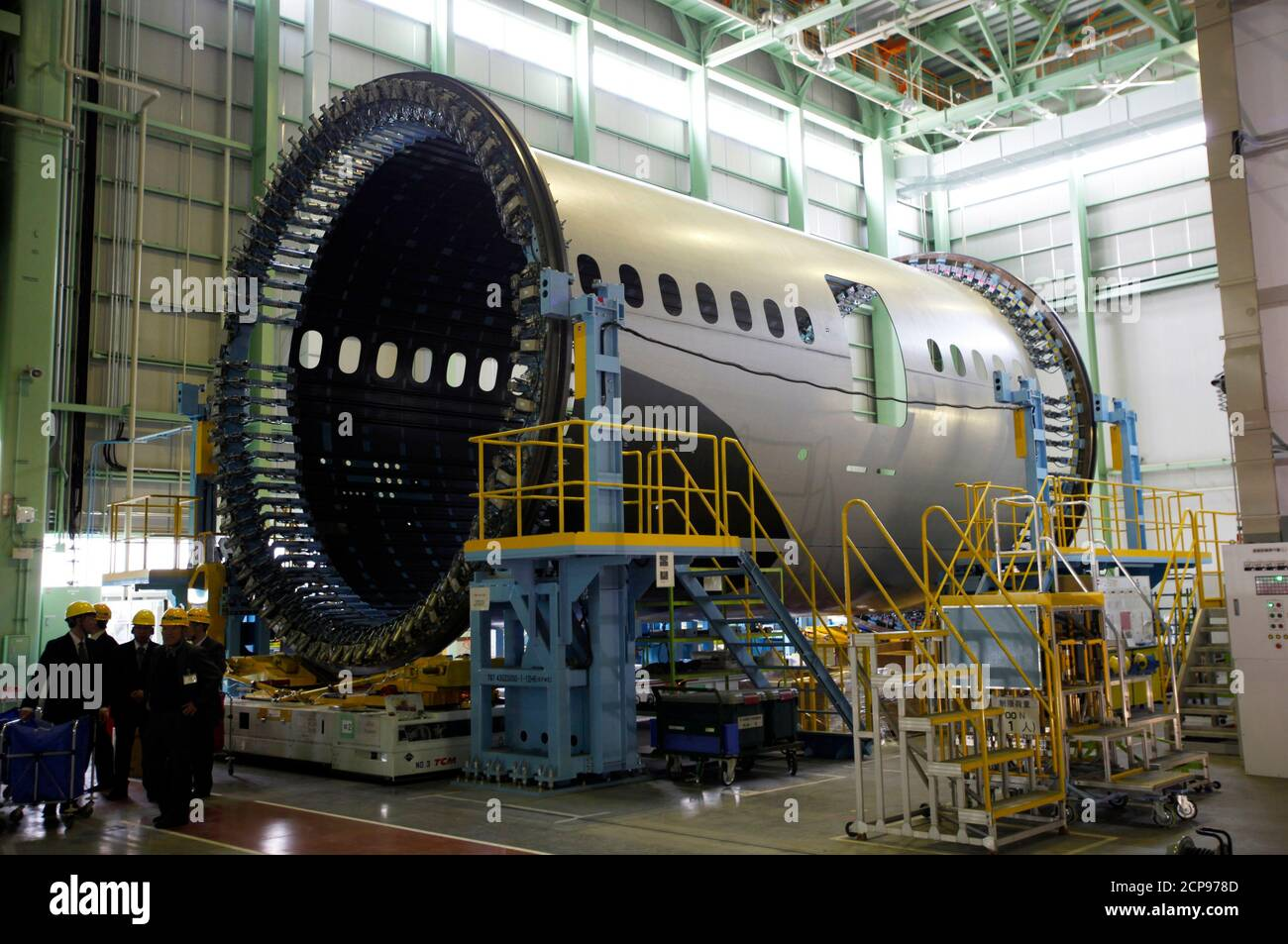 A forward fuselage of the Boeing 787 Dreamliner airplane is seen inside Kawasaki Heavy Industries' newly built manufacturing plant in Yatomi, central Japan, March 13, 2015. Kawasaki Heavy Industries Ltd opened a plant on Friday with an oversized kiln to bake and harden carbon fibre aircraft fuselage sections, giving it capacity to surpass Boeing Co's production targets for the 787 Dreamliner. The new 35 billion yen ($288.18 million) plant will build the forward fuselage for the Dreamliner, including the 330-seat stretch version slated for completion in 2017. REUTERS/Tim Kelly (JAPAN - Tags: TR Stock Photo