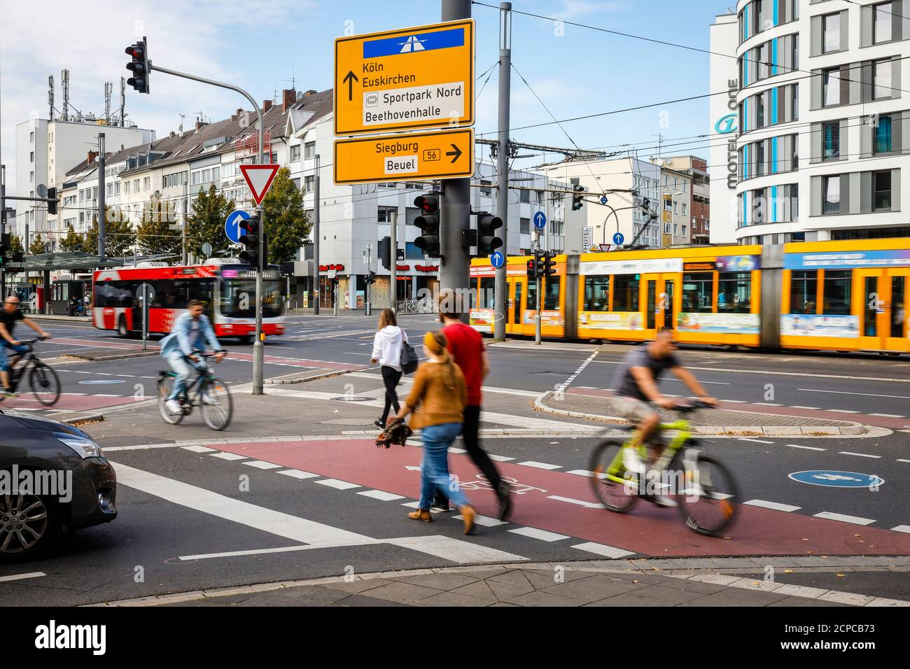 Bonn, North Rhine-Westphalia, Germany - street intersection with pedestrians, cyclists, cars, bus and tram. Stock Photo