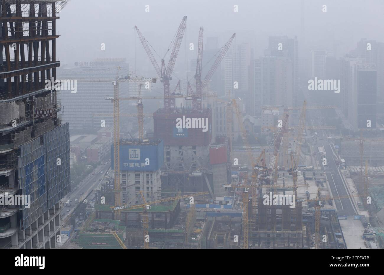 Construction sites are seen on a hazy day in Beijing's central business district June 25, 2015. U.S. President Barack Obama is expected to press Chinese leader Xi Jinping during the latter's state visit later this month on issues that have strained relations between the two countries, but his approach will be tempered because for better or worse the world's two biggest economies are inextricably bound together. Picture taken on June 25, 2015. REUTERS/Jason Lee Stock Photo