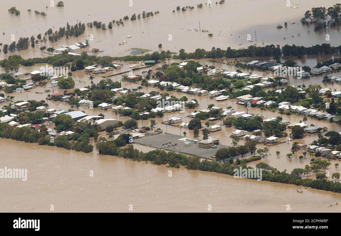 An aerial view of partially submerged houses in flooded Rockhampton in Australia's state of Queensland January 2, 2011. Large parts of Australia's coastal northeast were flooded on Sunday in a spreading environmental disaster as thousands of residents fled their homes to avoid the runoff from a Christmas deluge. REUTERS/Daniel Munoz (AUSTRALIA - Tags: DISASTER ENVIRONMENT IMAGES OF THE DAY) Stock Photo