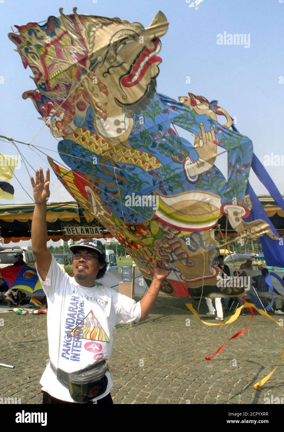 A contestant from central Java flies a kite which resembles a Indonesian shadow puppetc character at the International Kite Festival in Jakarta on July 7. Fourteen provinces in Indonesia and ten countries including Malaysia, Netherland and Japan, participated in the three day festival.  PRI/TS Stock Photo