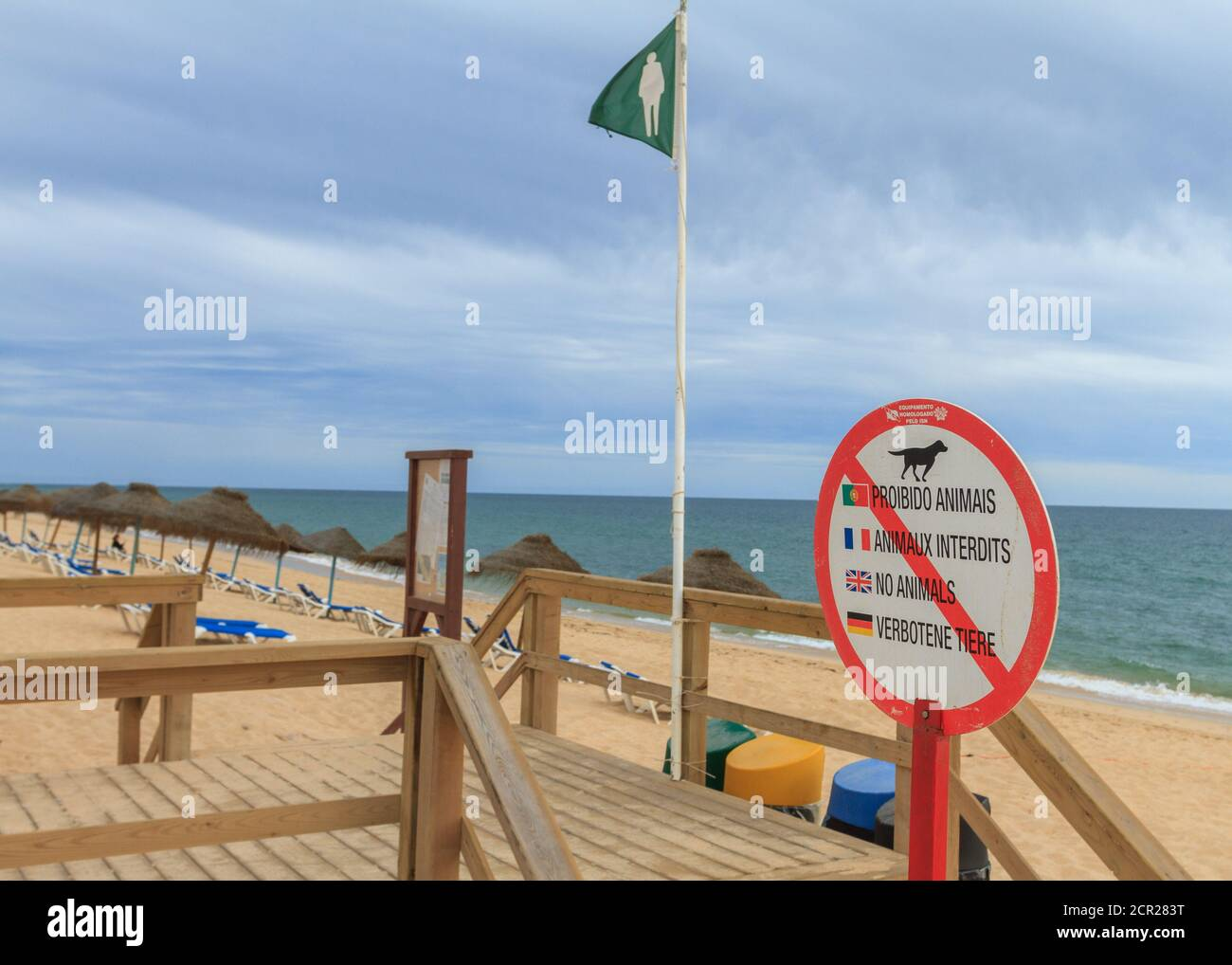 No animals sign at the beach entrance in Faro, Portugal. Multi-language sign; written in Portuguese, French, English and German. Stock Photo