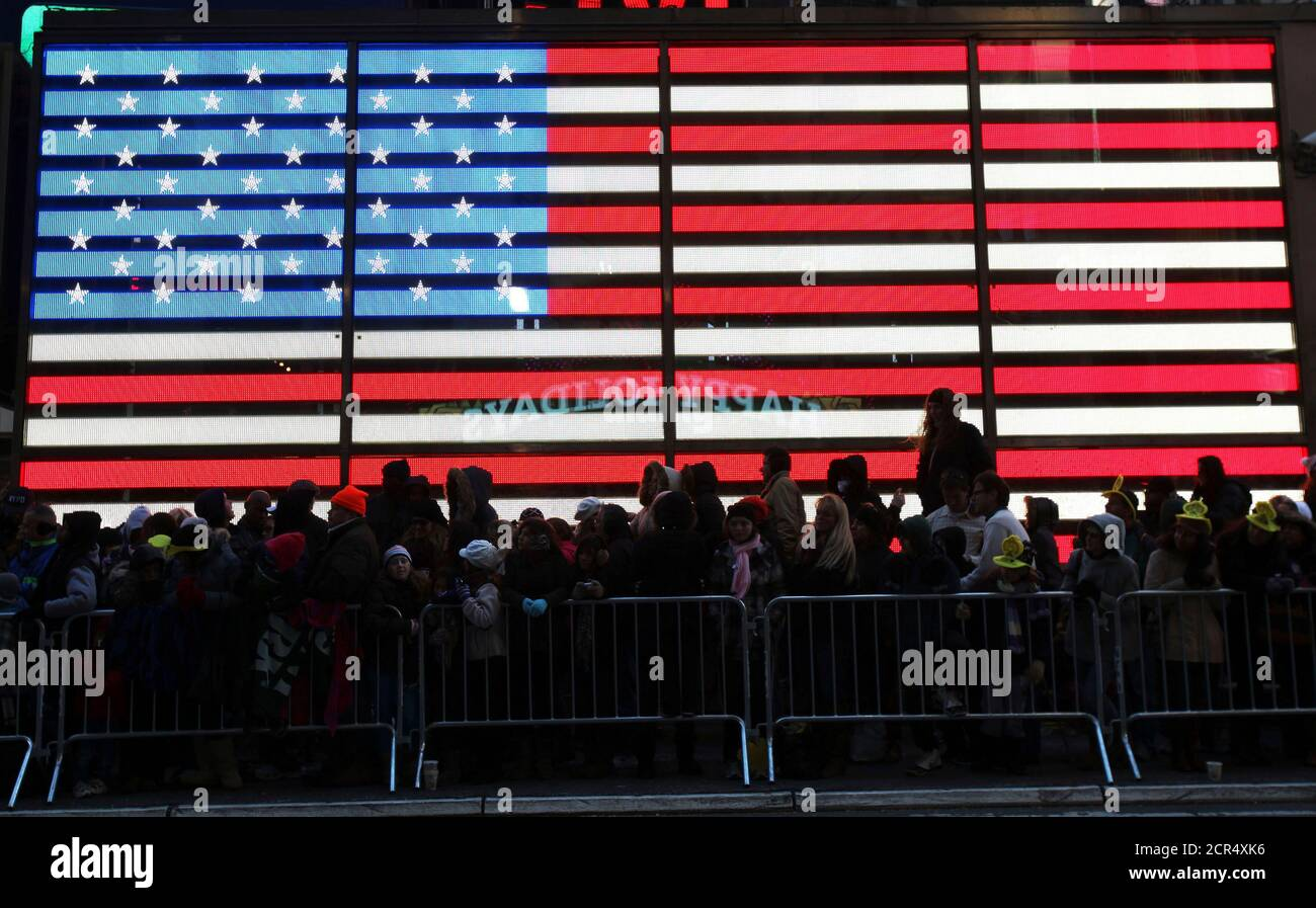 People watch as floats make their way through Times Square during the 85th annual Macy's Thanksgiving day parade in New York November 24, 2011. REUTERS/Shannon Stapleton (UNITED STATES - Tags: SOCIETY) Stock Photo