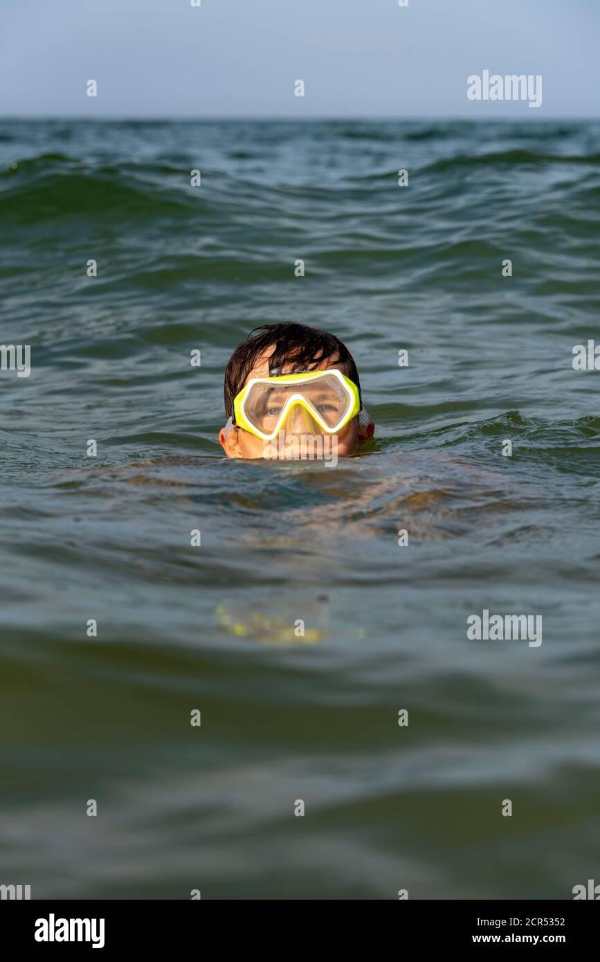 Germany, Mecklenburg-Western Pomerania, Ruegen Island, Baltic Sea resort Binz, boy with diving goggles, Baltic Sea Stock Photo