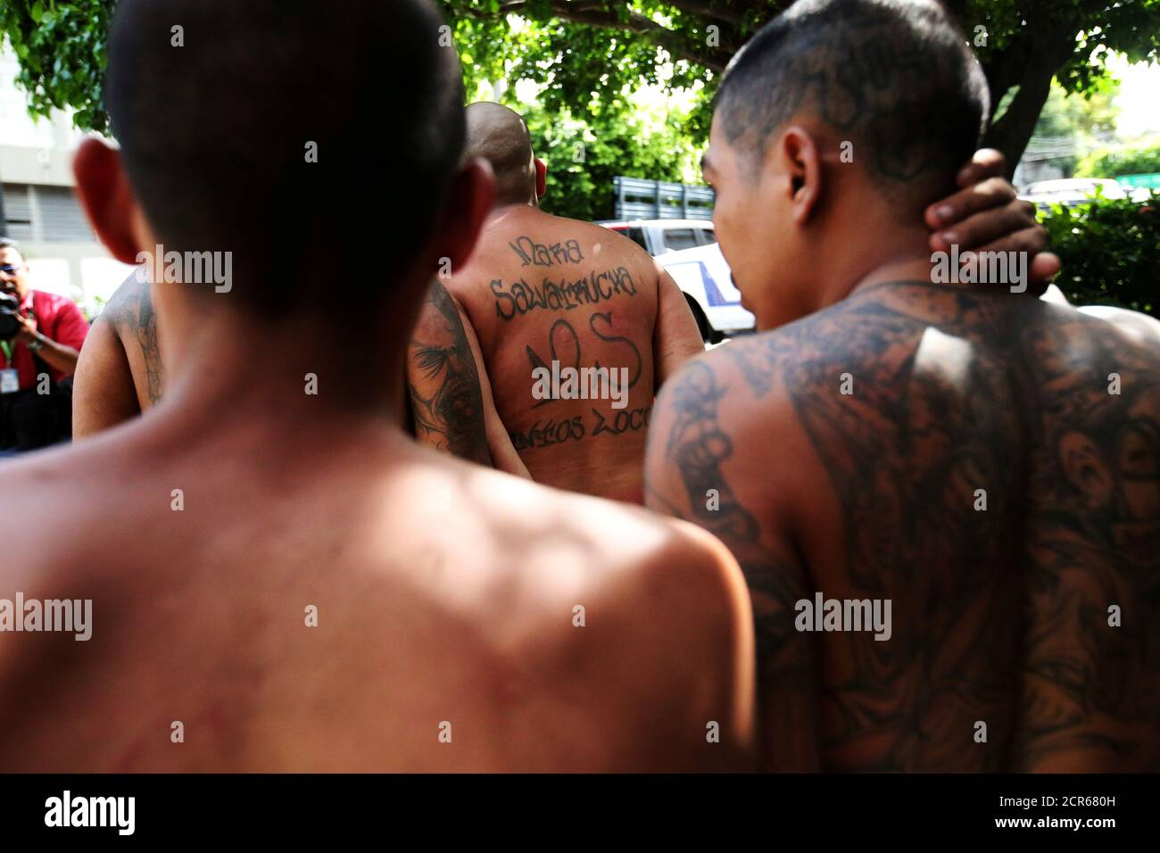 Members of the Mara Salvatrucha gang (MS-13) are escorted after being presented to the media after being detained by the police during a private party in San Salvador, El Salvador, August 10, 2017. REUTERS/Jose Cabezas     TPX IMAGES OF THE DAY Stock Photo
