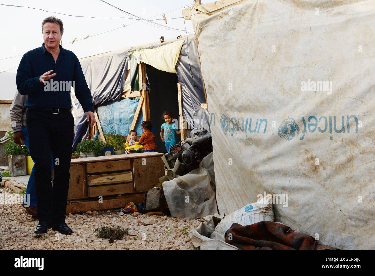 Prime Minister David Cameron visits a Syrian refugee settlement camp in the Bekaa Valley in Lebanon, September 14, 2015. British Prime Minister David Cameron arrived in Beirut on Monday to visit refugees from the war in neighbouring Syria, which has driven well over a million people into Lebanon and tens of thousands towards Europe, Lebanese media reported. Cameron will visit refugees and then meet with his Lebanese counterpart Tammam Salam. Lebanon, where one in every four people is a refugee, is hosting the greatest number of refugees per capita of any country in the world. It has called on  Stock Photo