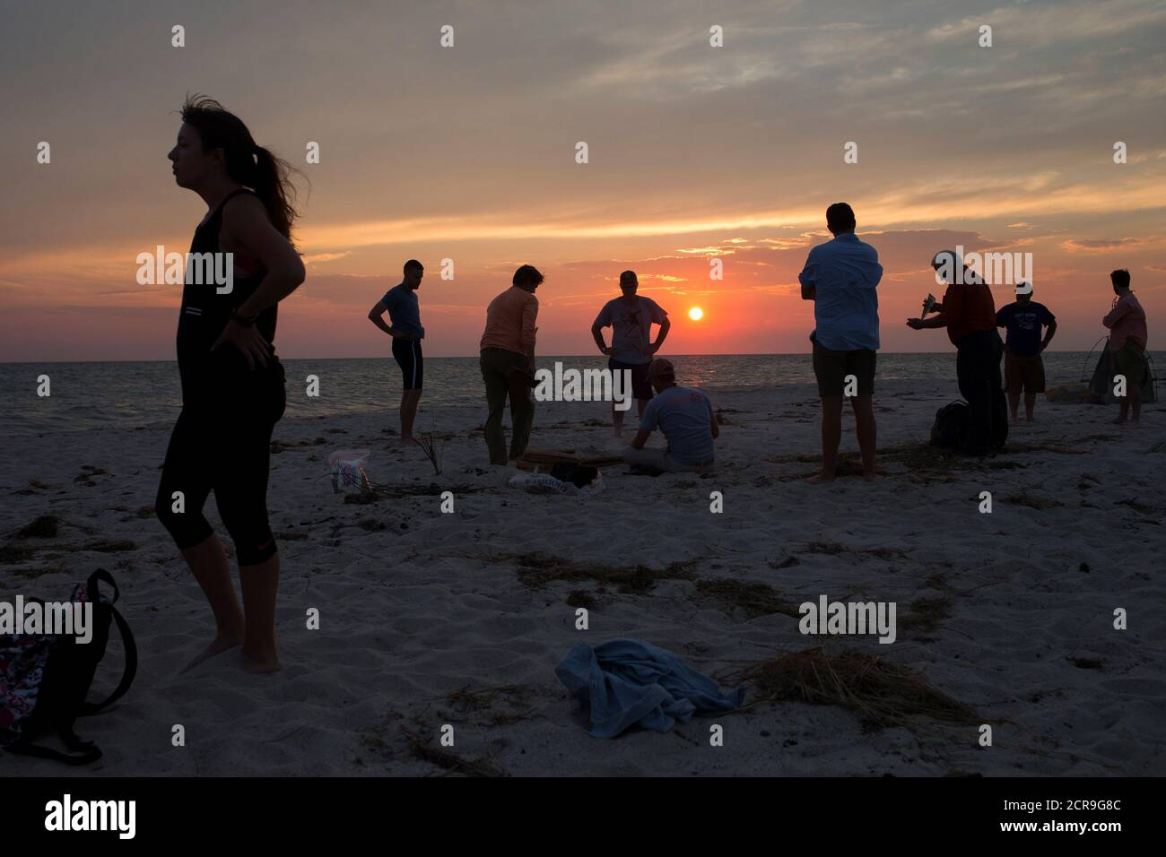 Visitors make a camp fire on a beach at sunset on Tangier Island, Virginia, U.S., August 3, 2017.  REUTERS/Adrees Latif Stock Photo