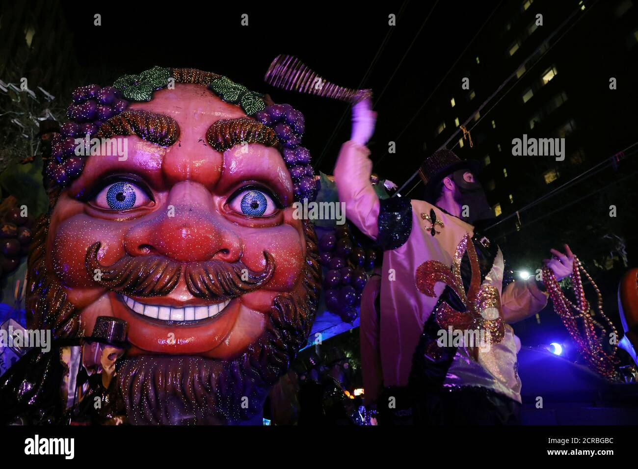 A float rider throws beads at the Bacchus parade during Mardi Gras in New Orleans, Louisiana U.S., February 26, 2017. REUTERS/Shannon Stapleton Stock Photo