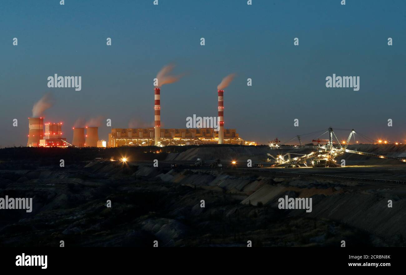 Belchatow Coal Mine, the biggest opencast mine of brown coal in Poland, outside Belchatow Power Station, Europe's largest coal-fired power plant operated by PGE Group, is pictured at night near Belchatow, September 12, 2018. REUTERS/Kacper Pempel Stock Photo