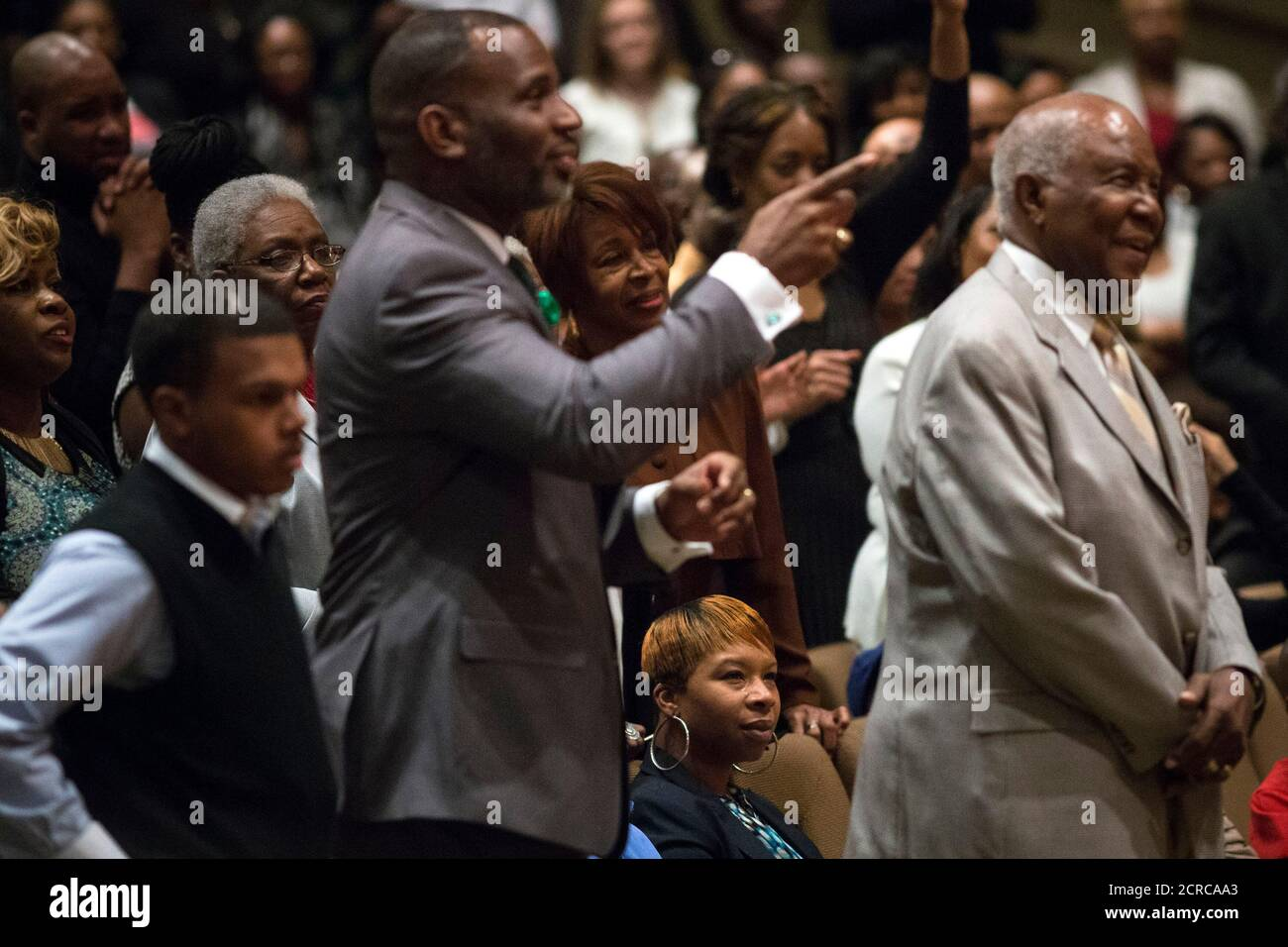 Michael Brown's mother Lesley McSpadden (seated) watches veteran civil rights activist Rev. Al Sharpton speak at the Friendly Temple Missionary Baptist Church in St. Louis, Missouri November 30, 2014. Sharpton preached on Sunday to a congregation of some 2,500 worshippers at the St. Louis church where Michael Brown's funeral was held in August. The dead teen's parents were among the congregation.  REUTERS/Adrees Latif  (UNITED STATES - Tags: CRIME LAW CIVIL UNREST POLITICS RELIGION) Stock Photo