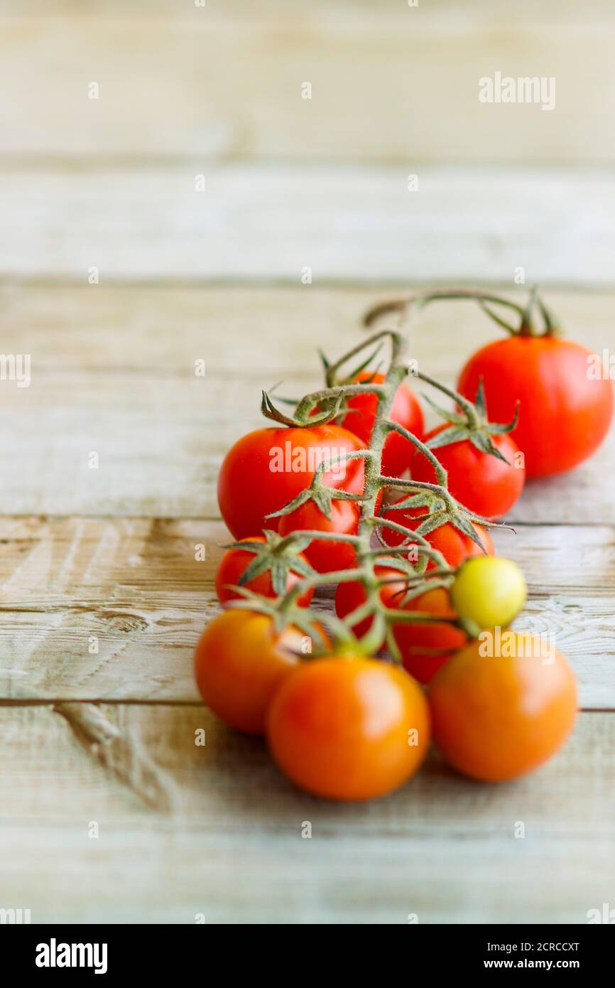 View of beautiful red cherry tomatoes on wooden background Stock Photo