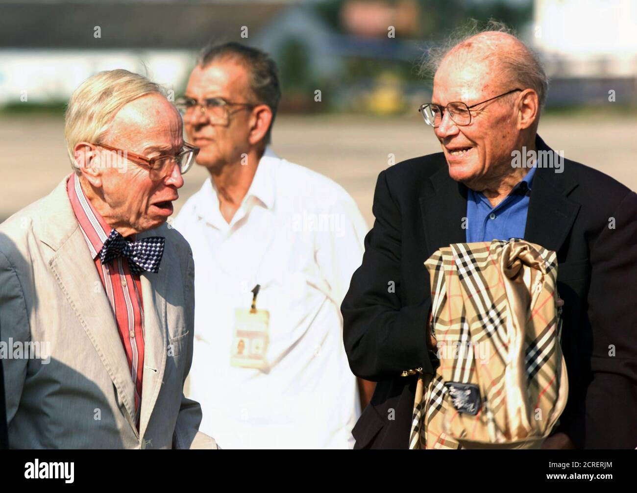 Former Secretary of Defense Robert McNamara (R) and special aide to the President Arthur Schlesinger arrive in Havana, October 10, 2002. McNamara and Schlesinger, who both worked during the John F. Kennedy administration, are part of a U.S. delegation participating in a gathering to talk about the 1962 Cuban missile crisis. REUTERS/Rafael Perez  RP Stock Photo