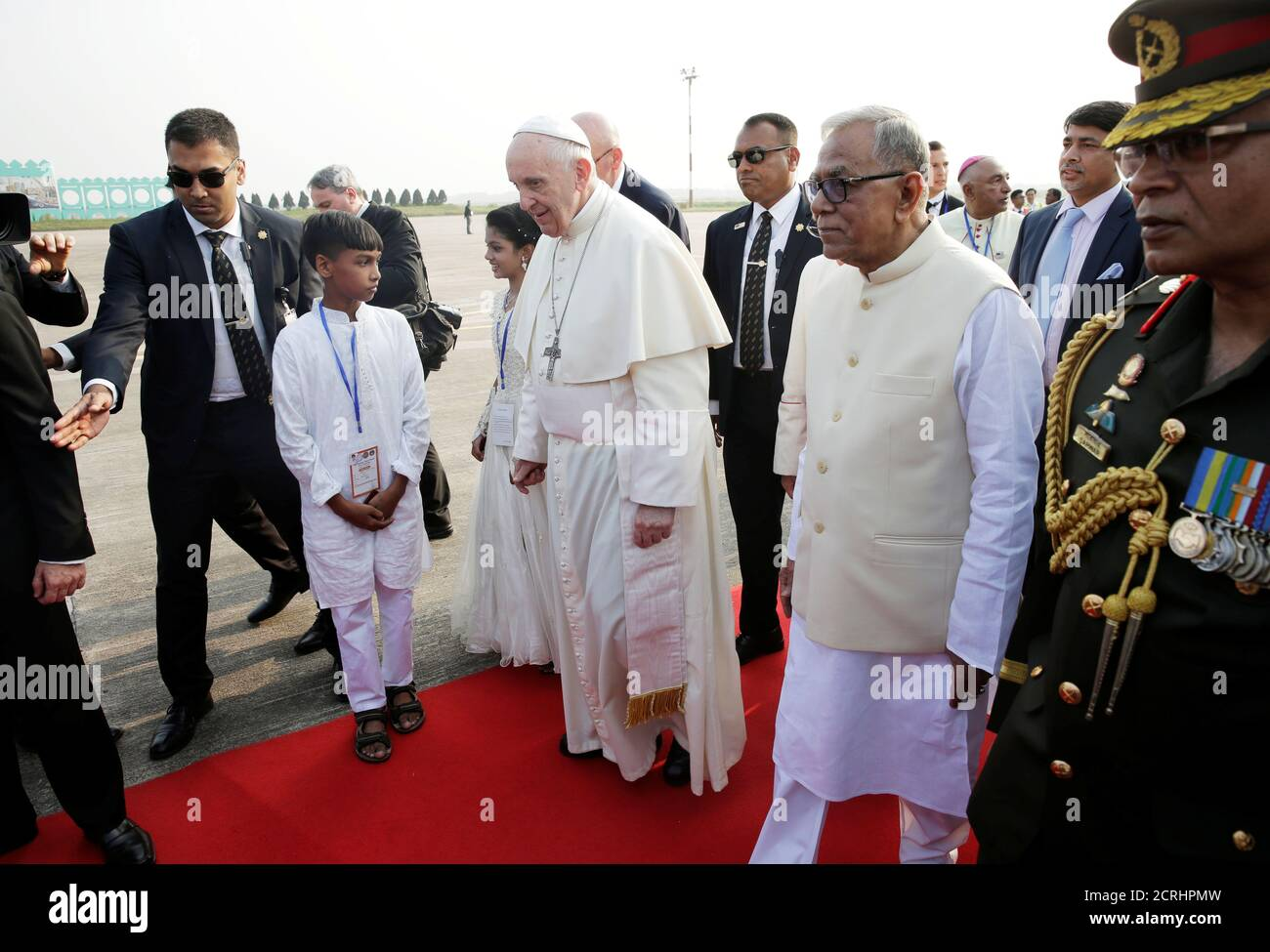 Pope Francis walks with Bangladesh's President Abdul Hamid after arriving at the airport in Dhaka, Bangladesh November 30, 2017.  REUTERS/Max Rossi Stock Photo