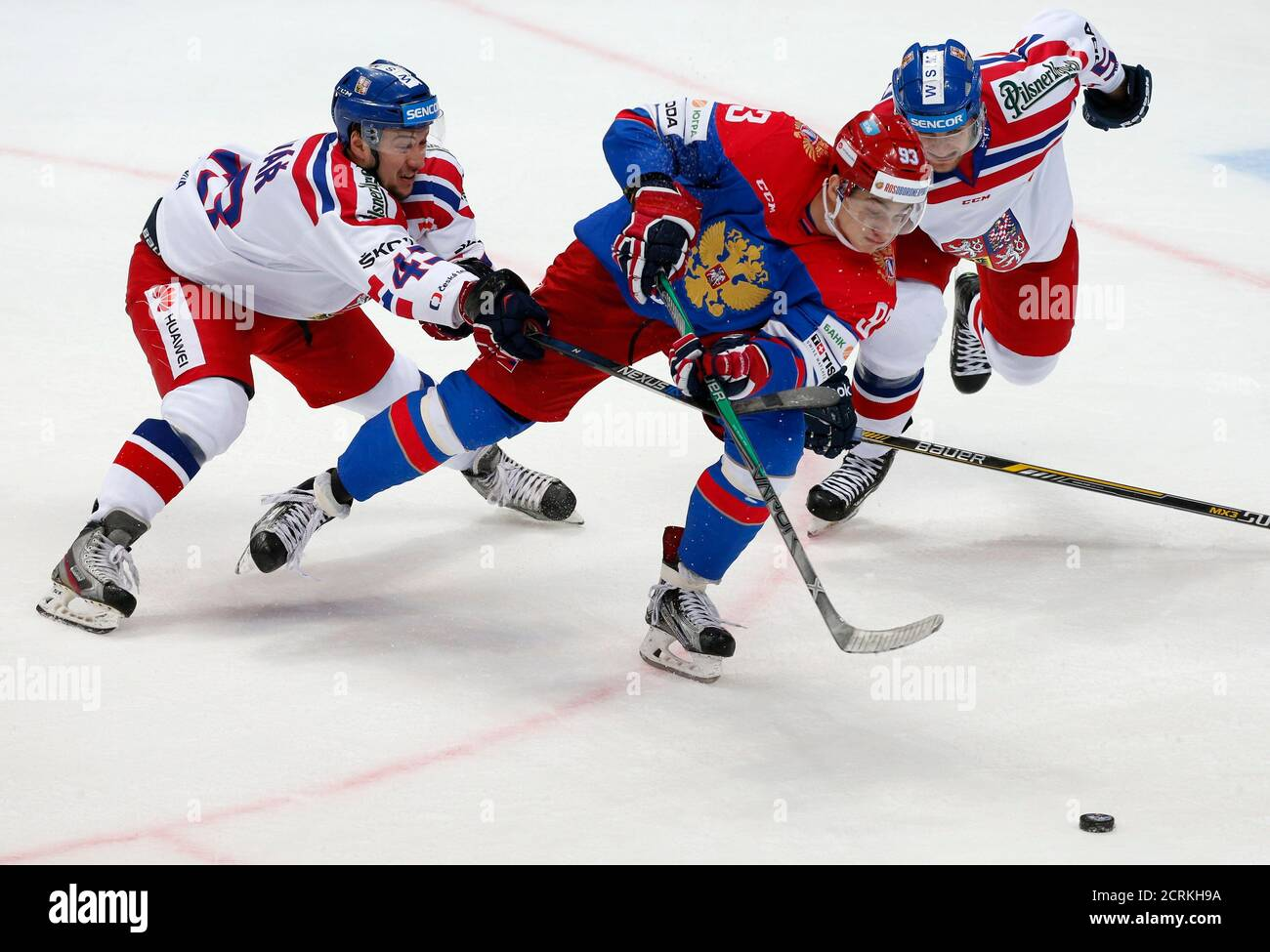 Czech Republic's Jan Kovar (L) and Jakub Jerabek chase Russia's Nikolay Prokhorkin (C) during their Channel One Cup ice hockey game in Moscow, Russia, December 20, 2015. REUTERS/Maxim Zmeyev Stock Photo