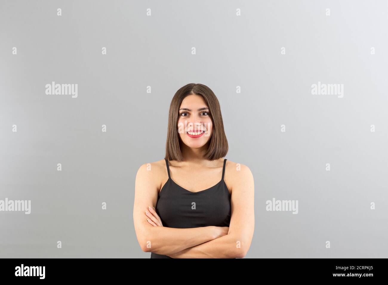 Young beautiful Turkish woman view in confident mood, isolated studio shot with copy space Stock Photo