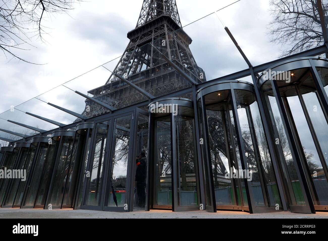 New control glass gates are seen at the bottom of the Eiffel Tower in Paris, France, March 31, 2018. REUTERS/Gonzalo Fuentes Stock Photo