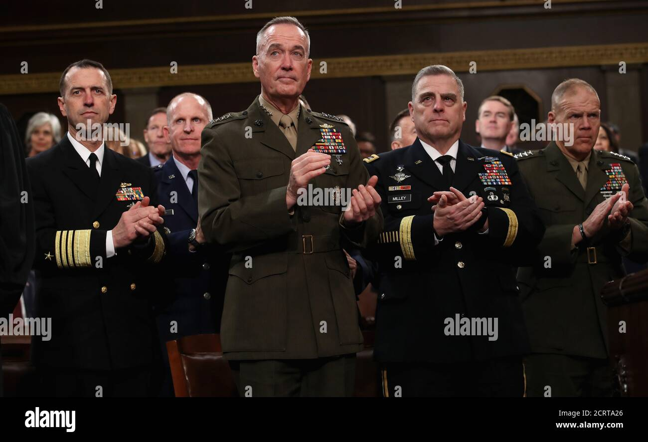 Chief of Naval Operations Adm. John Richardson , Chairman of the Joint Chiefs of Staff Gen. Joseph Dunford, Chief of Staff of the Army Gen. Mark Milley, and Commandant of the Marine Corps Gen. Robert Neller  (L-R) applaud as U.S. President Donald Trump delivers his first State of the Union address to a joint session of Congress inside the House Chamber on Capitol Hill in Washington, U.S., January 30, 2018. REUTERS/Win McNamee/Pool Stock Photo