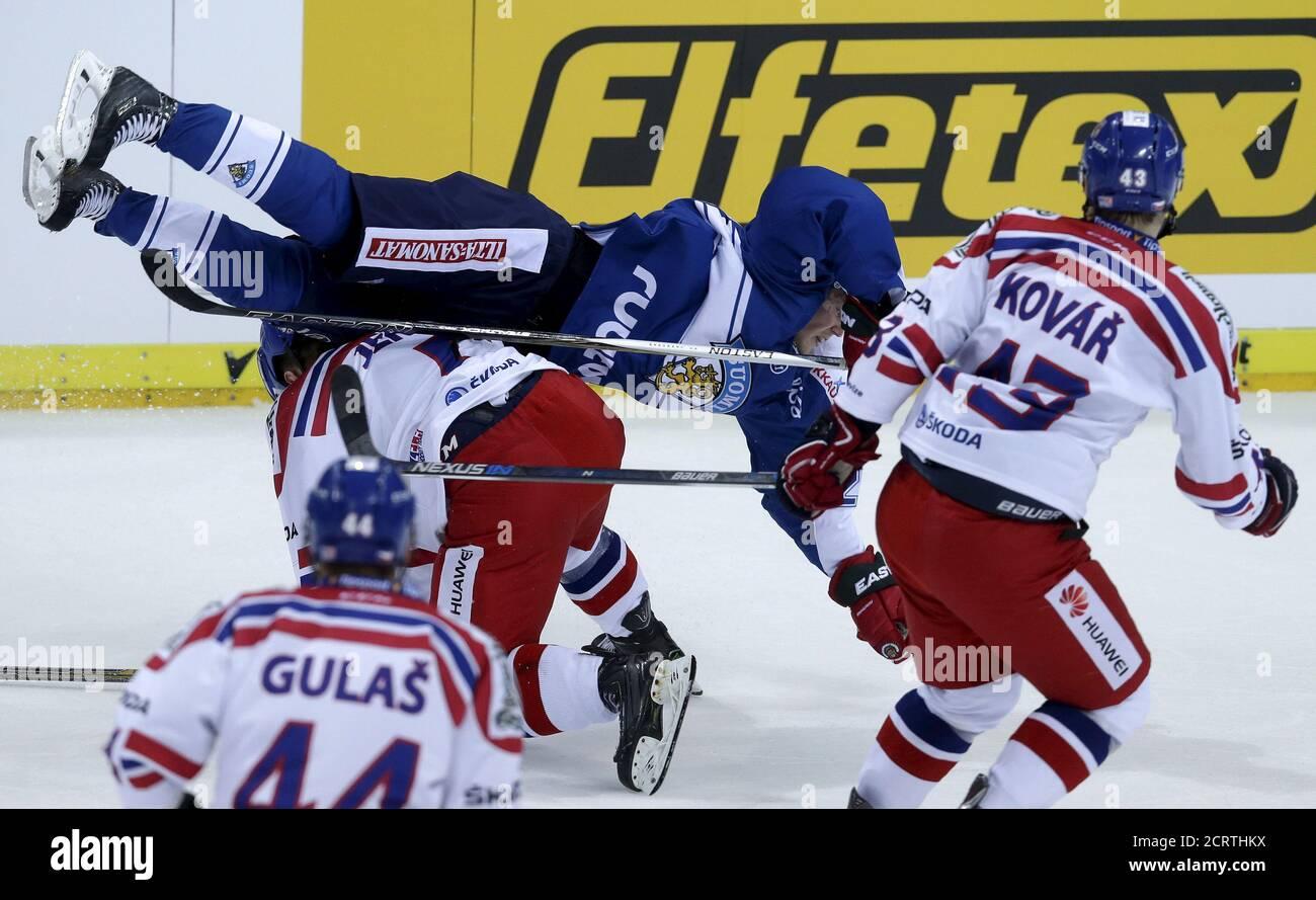 Finland's Artturi Lehkonen (top) flips over Czech Republic's Jakub Jerabek during their Euro Hockey Tour ice hockey match in Prague, December 17, 2015. REUTERS/David W Cerny Stock Photo