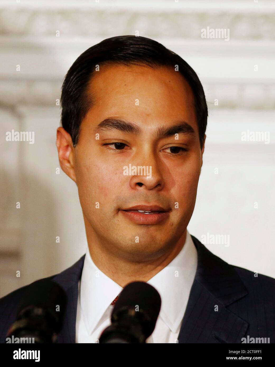San Antonio Mayor Julian Castro (L), who is U.S. President Barack Obama's choice as the new Secretary of HUD, is pictured in the State Dining Room at the White House in Washington May 23, 2014.    REUTERS/Larry Downing   (UNITED STATES - Tags: POLITICS HEADSHOT) Stock Photo
