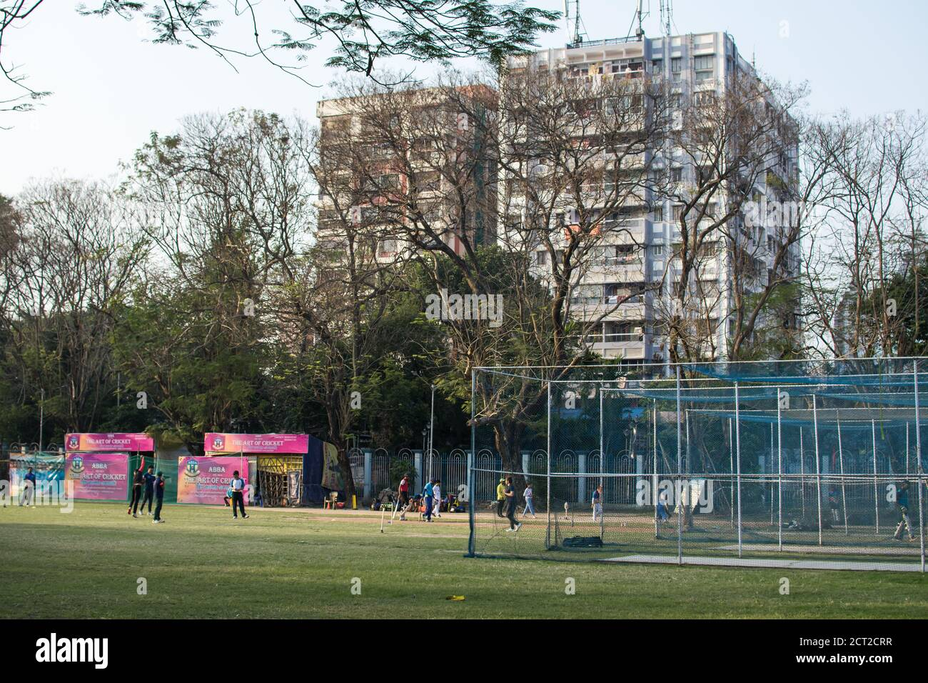 Kolkata, India - February 1, 2020: Several unidentified people plays cricket in everyday clothes in Minhaj Gardan park on February 1, 2020 in Kolkata Stock Photo