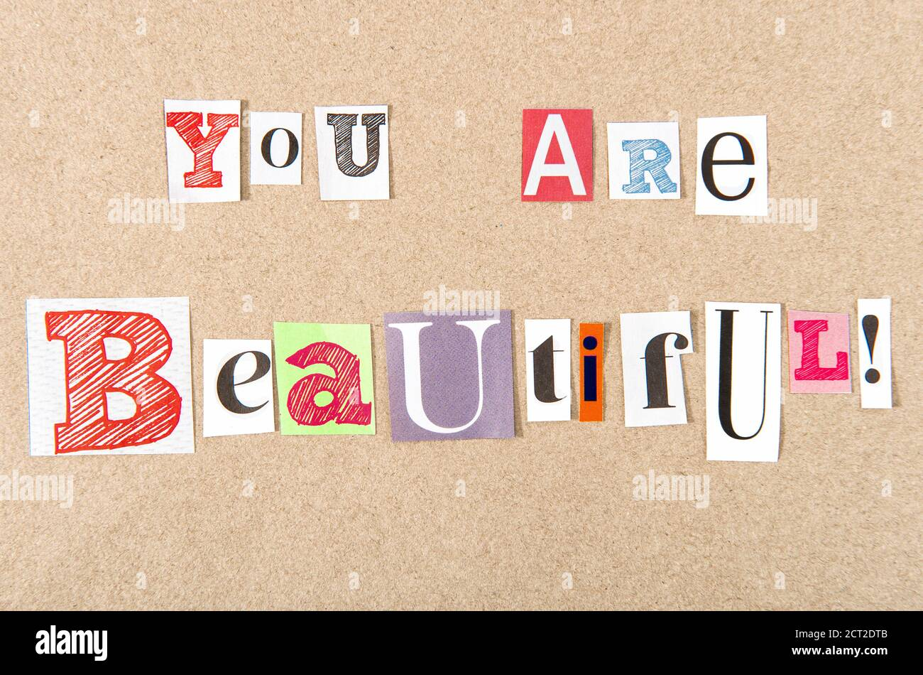 Paper cut letters. Newspaper magazine cutouts. Ransom style collage You are beautiful Stock Photo