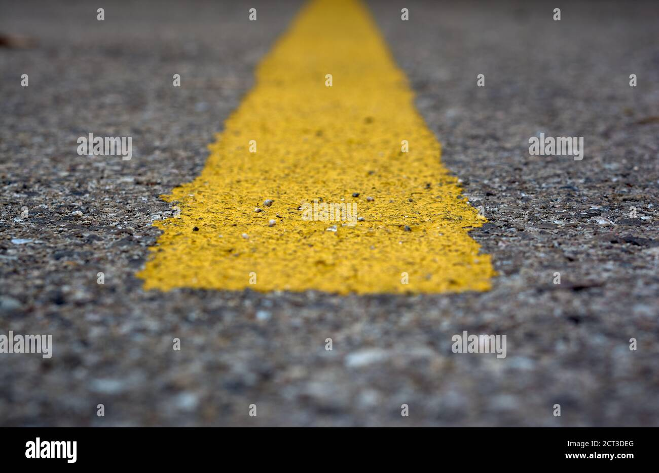 detail of a horizontal yellow line painted on the asphalt Stock Photo