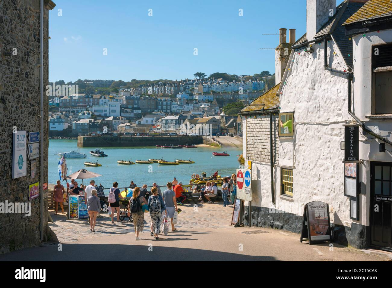 Cornwall town, view in summer of people approaching the harbour area in St Ives, Cornwall, south west England, UK Stock Photo