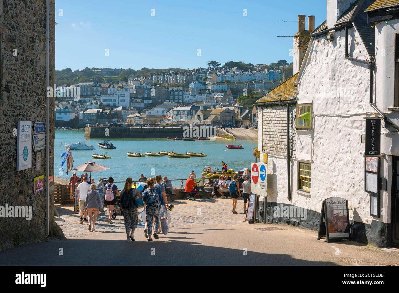 St Ives Cornwall, view in summer of people approaching the harbour area in St Ives, Cornwall, south west England, UK Stock Photo