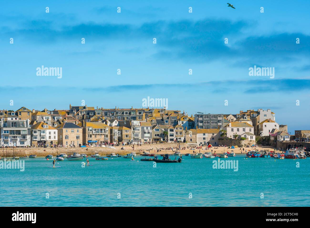 Cornwall property, view in summer across St Ives harbour towards beachfront property, Cornwall, south west England, UK Stock Photo
