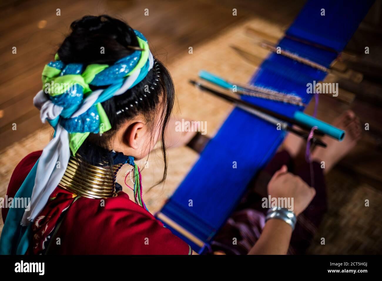 Lock neck woman from Palaung tribe weaving at Inle Lake, Shan State, Myanmar (Burma) Stock Photo