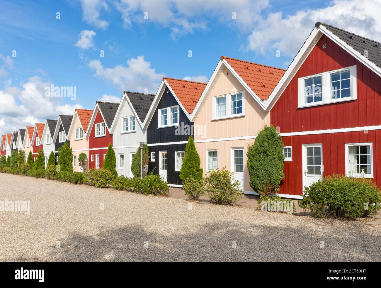 Row of almost identical wooden holiday homes in Denmark Stock Photo