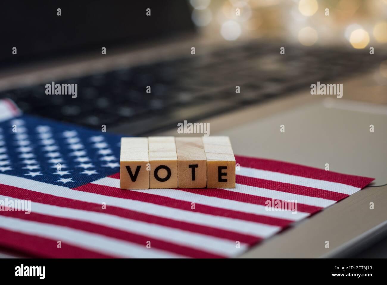VOTE letter blocks concept on laptop keyboard Stock Photo