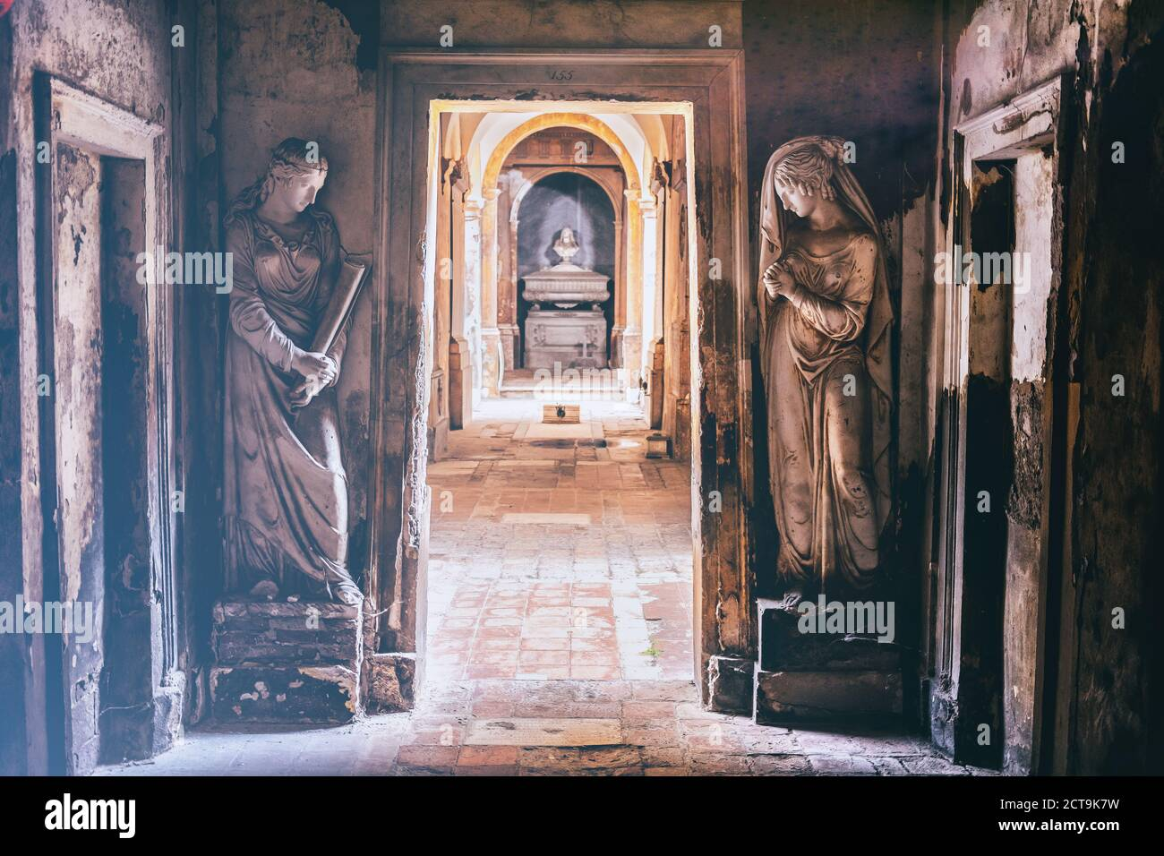 cemetery corridor background with two statues in a vintage camera film effect look. Stock Photo